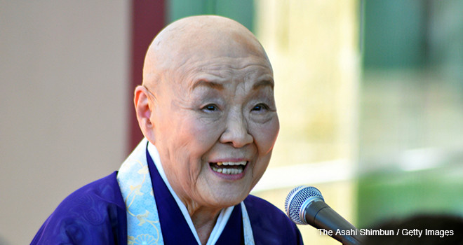 NAGASAKI, JAPAN - JULY 25:  (CHINA OUT, SOUTH KOREA OUT) 93-year-old female monk and writer Jakucho Setouchi talks during a special lecture at the Nagasaki Prefectural Art Museum on July 25, 2015 in Nagasaki, Japan. In declaring her opposition to the government's rush to enact controversial security legislation, the revered Buddhist monk and writer Jakucho Setouchi said Japan is following the same path it pursued before World War II.  (Photo by The Asahi Shimbun via Getty Images)